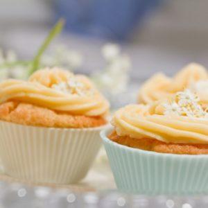 Decorated elderflower cupcakes close up