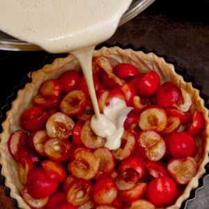 Heritage Cherry Tart - pouring in the custard