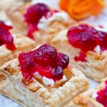 cranberry, cointreau and clementine sauce on mini pastries