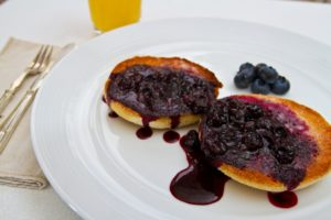 Blueberry sauce over toasted muffins