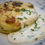 spring green and bacon potato cake with cheddar and chive sauce