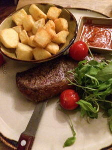 steak with patatas bravas
