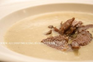 Jerusalem artichoke and leek soup topped with collar bacon