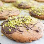 Decorating chocolate pistachio biscuits