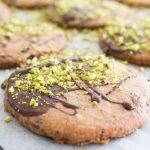 Decorating chocolate pistachio biscuits
