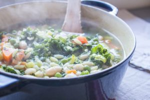 stirring the vegetable minestrone