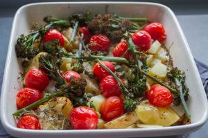Potatoes, purple sprouting broccoli and potatoes in spring tray bake