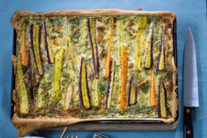 Rainbow carrot tart with summer herbs and goat's cheese