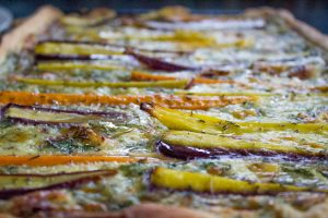 Rainbow carrots in cheese and herb tart