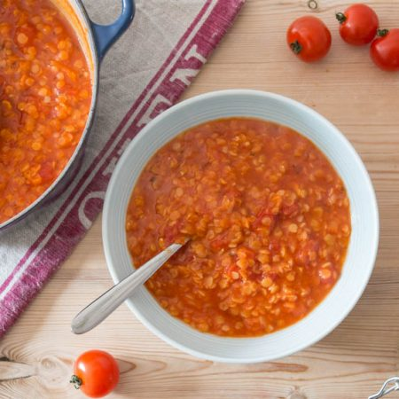 red lentil and tomato soup served in bowl