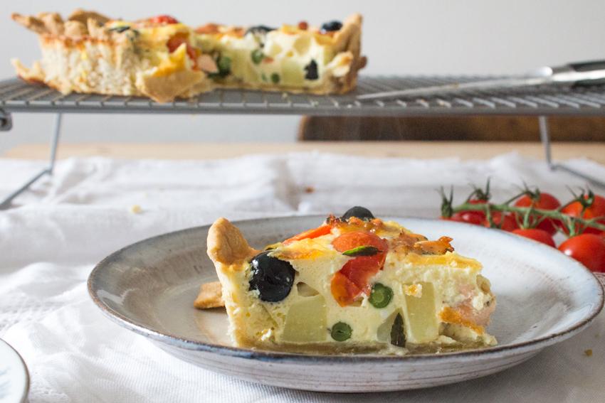Salmon and salad quiche baked and sliced